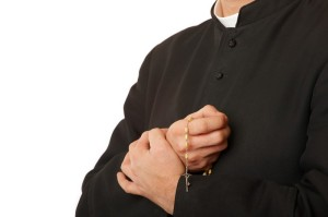 catholic priest holding rosary